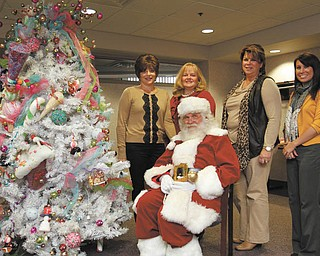 Members of Kids' Crew of Akron Children's Hospital Mahoning Valley are serving on the event committee for the Jingle Bell Bash, Breakfast with Santa and Holiday Trees of the Valley display that will benefit the hospital. Visiting with Santa, who will be a special guest at the breakfast, are, from left, Margaret Nigro, Joann Stock, Debbie Shattuck and Kelsey Rupert.  PHOTO BY ROBERT K. YOSAY | THE VINDICATOR