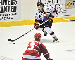 Phantoms forward Sam Anas (7) brings the puck up the ice while Dubuque's Kyle Mckenzie defends during a recent game at the Covelli Centre.