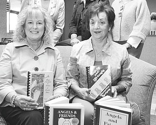 Angels of Easter Seals Holiday Brunch and Sweet Shoppe committee members, shown with copies of their cookbooks, are, seated, Lynn Sahli, left, reservations, and Joan Zarlenga, president; and standing are Jeannine Hodge and Joyce Dowell, co-chairwomen; and Cheri Raschilla, reservations. PHOTO BY: William D. Lewis | The Vindicator