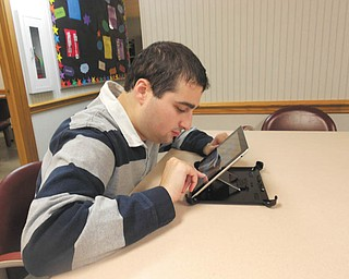 As a result of an open house Sept 19 at Easter Seals Skill Development Center, 717 Boardman-Poland Road, Boardman, the organization received a donation of an IPad from Eric Broviak.  The center aids young adults with autism spectrum. Shown is a client using the IPad.