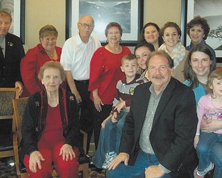 The family of Elsie Sheppard recently celebrated her 95th birthday with a get-together at Holiday Inn, Boardman. She also celebrated with her Red Hat Society group, the Old Timers and her TOPS club. She also received birthday wishes from radio station 1570 AM. Seated in front is Sheppard, her son, Ken Veisz; Keaton, Ashley, Max, Lori, Kamiren and Pat Veisz; Clarissa Whippo; daughter, Carol Bovee; Harry Bovee; Donna Graham and son, Bud Graham.