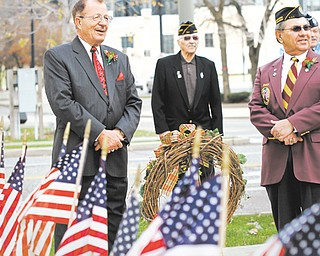 Col. Walter Duzzny, left, and Bill Pacak prepare to lay the wreath at the Civil War monument in downtown Youngstown during a Veterans Day observance Sunday.