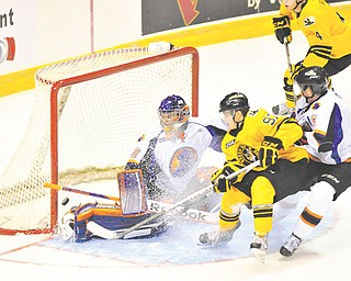Green Bay's Grigory Dikushin gets the puck past Phantoms goalie Sean Romeo for the Gamblers' first goal of the game Sunday.