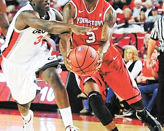Youngstown State guard Kendrick Perry (3) drives to the basket against Georgia's John Florveus (32) during Monday's NCAA basketball game in Athens, Ga. The Penguins downed the Bulldogs, 68-56, behind Perry who posted 23 points and six rebounds.