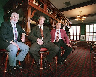 The Youngstown Club in the Commerce Building downtown is closing its doors. In the club's Grill Room during its better days are, from left, Bob Doyle, club membership director; Richard Keyse , club president; and David Ventresco , general manager.