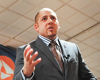 Kevin Hines, one of a few people who survived a suicide attempt by jumping from the Golden Gate Bridge in San Francisco, speaks at a suicide-prevention workshop at Antone's Banquet Center, Boardman.