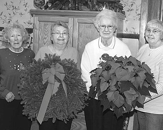 Preparing for the Friends of the Children's Aid Society Christmas sale Nov. 29 and 30 are, from left, Julie Anhalt, Carol Clark, Joan Foster and Liz Bolster. This fundraiser is an annual event that helps  provide toys and clothing to the community. PHOTO BY: NICK MAYS | SPECIAL TO THE VINDICATOR