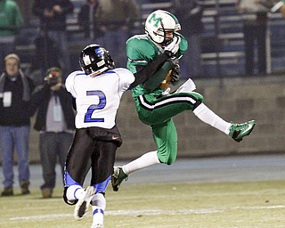 ROBERT  K.  YOSAY  | THE VINDICATOR --..#2 Darien Townsend tries to break up a pass  for 40+ yards to #36   Gary Strain  during second quarter action - .YCS  vs Mogadore  at  Ravenna...(AP Photo/The Vindicator, Robert K. Yosay)