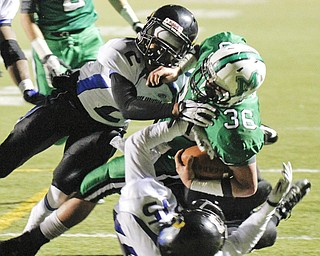 ROBERT  K.  YOSAY  | THE VINDICATOR --..Mogadores #36  Gary Strain is stopped at the 4 yard line by  YCS  #2   Darien Townsend and #15 Robert Thompson..YCS  vs Mogadore  at  Ravenna...(AP Photo/The Vindicator, Robert K. Yosay)