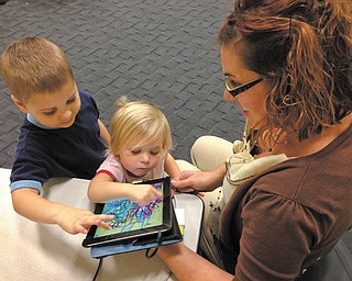 """Connie Spin of Boardman attended an iPad story time at the Newport Branch with her daughter, Sydney, 2, and son, Jackson, 4. """"They like to play on the iPad and the iPhones a lot,"""" she said of her children."""