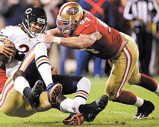 Chicago Bears quarterback Jason Campbell (2) is sacked by San Francisco 49ers linebacker Aldon Smith, left, as defensive tackle Justin Smith (94) converges during the first quarter of an NFL game in San Francisco on Monday. The 49ers won 32-7.