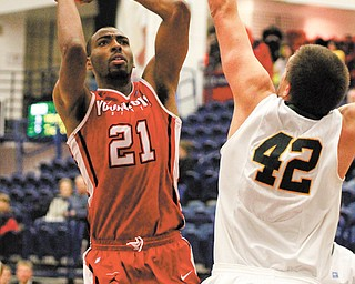 Youngstown State's Damian Eargle (21) shoots over North Dakota State's Marshall Bjorklund (42) during the second half of Monday's game at Duquesne University's Palumbo Center in Pittsburgh. Eargle finished with eight points and six rebounds in Youngstown State's 83-80 overtime loss against the Bison.