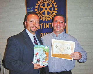 Doug Gough, men's services client adviser from Rescue Mission of Mahoning Valley, was the guest speaker at a recent meeting of the Austintown Rotary. Since 1893, the Rescue Mission has sheltered the homeless and fed the hungry. Shown with Rotary President-elect Mark Cole is Doug Gough receiving a certificate for a book to be donated to the Woodside Reads Project. For information or to offer aid, call the Rescue Mission at 330-744-5486 or visit 2ndChance@RescueMissionMV.org.