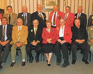 Past District Governors of area Lions Clubs who met recently at A La Cart Catering in Canfield are, in front from left, Chuck Allcorn, David Rice, Donald Martin, Verna Williams, Dwain Hawkins, Ron Clifton and Bud Jenkins. In back are, from left, Ted Filmer, Paul Metrovich, Bob Whited, Jeff Snyder, Bob Booher, Don Heldman, Governor John Woodside and Harold Ullman.