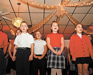 Third- through fifth-graders at St. Nicholas School of Christ Our Savior Parish in Struthers sing a variety of songs relating to giving thanks at the Mayors' Prayer Breakfast on Tuesday. The event was sponsored by Mahoning Valley Association of Churches at the Mahoning Country Club in Girard.