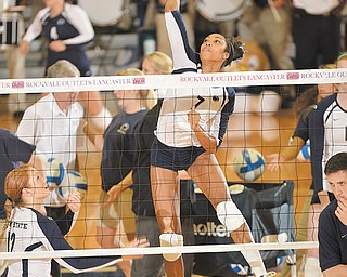 Howland graduate Nia Grant (7) goes up for a kill during a recent match. Grant, a sophomore, is a starter at middle hitter for Penn State. The Nittany Lions are a perennial NCAA power and are ranked No. 2 this season.