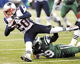 New England Patriots strong safety Steve Gregory (28) is tackled by New York Jets running back Bilal Powell after intercepting a pass during the first half of a game Thursday in East Rutherford, N.J.