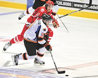 Phantoms forward Austin Cangelosi (9) looks for help during a recent game against Dubuque at the Covelli Centre.
