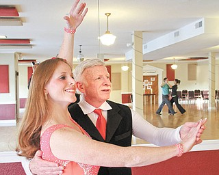 Angela Gorby and her father, Bob Koehler, dance at the Fred Astaire Dance Studio in Boardman. The daughter-dad dance duo competed in the Fred Astaire World Championships in San Juan, Puerto Rico, this summer and waltzed their way to a first place for a Viennese waltz. Photo by: William D. Lewis | The Vindicator.