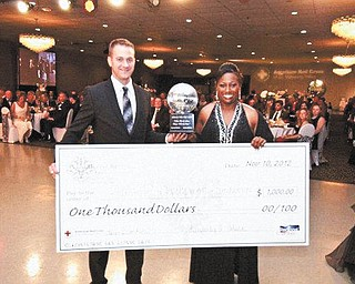 """Nikki Carter, right, director of program development for Humility of Mary Health Partners, won the celebrity dance competition at the """"Shoot for the Moon, Dance with the Stars"""" Black & White Gala on Nov. 10, co-hosted by the Youngstown/Warren Regional Chamber and the American Red Cross of the Mahoning Valley. The event took place at Mr. Anthony's in Boardman. With her is her professional partner Matt Moore of Fred Astaire Dance Studio of Boardman. Carter designated the HMHP Foundation as the recipient of the $1,000 cash prize."""