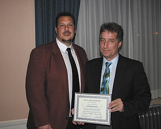 At an awards night recently at the Masonic Temple on Wick Avenue, Youngstown, Excellent Companion Timothy N. Flack, right, a 23-year member of the Youngstown chapter, was presented the Certificate of Achievement for his advanced studies in Royal Arch Masonry. Presenting the award to Flack is District Deputy Grand High Priest Zel E. Bush. Flack also received a plaque at the Grand Chapter for his dedication and appreciation of Capitular Masonry.