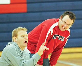 Dan Horacek watches coach John Hudson during a practice. Horacek teaches at the University Project Learning Center, an alternative school in the Youngstown district.