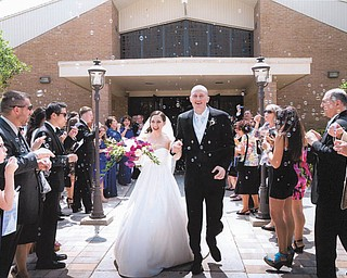 The May 26 wedding of Marlana LaCivita of Liberty and Guy Harris of Tampa was a joyous occasion. They are leaving St. Mary Church in Tampa into a crowd of well-wishers and bubbles. Photo submitted by Marie and Bob LaCivita of Liberty.