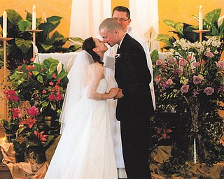 For Marie and Bob LaCivita of Liberty, the May 26 wedding of their daughter, Marlana, and Guy Harris of Tampa was a joyous occasion. The Very Rev. John Keehner of Youngstown, in the background, performed the ceremony at St. Mary Church in Tampa.