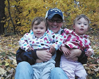 Gianna Duponty with twin daughters Olive and Ellie.