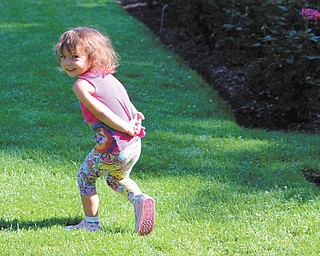 Ella Thomas, daughter of Kristi and Bob Thomas of Poland, is enjoying a day at the Rose Garden in Mill Creek Park. The photo was taken and submitted by Grandma Gena Murray.