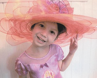 """It appears 4-year-old Megume of Youngstown would enjoy becoming a """"pink hat"""" of the Red Hat Society."""