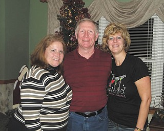 """Leann Exley of Pulaski, Pa., right, says """"Holiday gatherings with my siblings are always a 'joy' due to my sister's name: Vera Joy Mccleery, of New Castle, left."""" In the middle is brother Ed Peterson of Johnson City, NY."""