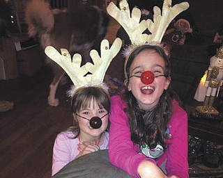 Nancy Fawcet of Canfield sent this is a picture of her two little reindeer, granddaughters Becca Geissler (8) and Lorelai Geissler (6).