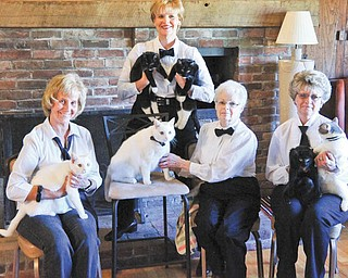The Humane Society of Columbiana County, 1825 S. Lincoln Ave., is preparing for its Black-Tie Adoption event Saturday through Dec. 8. In front are Lora Herbert, left, with Madonna; adoptable Micheal; Sally Geary; and Darlene Jenkins with Max and Julie; and standing is JayDee Palmer with Mystic and Mr. E. A reception with refreshments from 2 to 4:30 p.m. Saturday will kick off the event. Adoption fees are $15 for cats and kittens and $75 for dogs. All-black or mostly black kittens and cats are $10 and dogs are $50. Standard adoption criteria applies. All adoptable pets are spay/neutered, up to date on vaccines, tested and microchipped. For information call 330-332-2600 or visit www.columbianahumane.org.