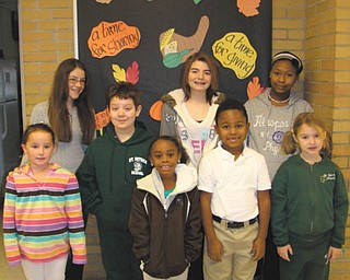 Students at St. Patrick School, Hubbard, conducted two dress-down days to raise money for victims of Hurricane Sandy. They raised more than $200 that will be sent to Catholic Charities to assist in the recovery process. Shown in front are Kara Leonard, left, Nate Wirtz, Maya Taylor, Anthony Carter and Isabella Bancroft. Behind them are Marie Bond, left, Arinna Sop and Trinity Adams. The students hold dress downs each month to help various charities and families in need in the community.