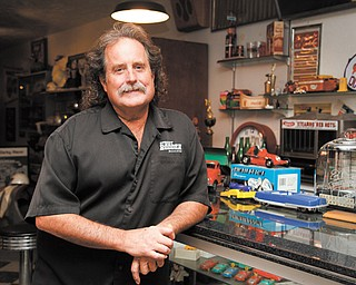 Jerry Dixey stands in his showroom at Ohio Van and Truck Supply on Mahoning Avenue. Dixey sold the business five years ago to lead street-rod tours across the U.S. He keeps a showroom at the property to display automotive memorabilia.