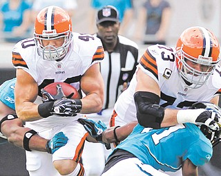 """Cleveland Browns left tackle Joe Thomas (73) once blocked and did all he could to protect Peyton Hillis (40. But on Wednesday, Thomas blasted his former teammate, calling Hillis """"a terrible distraction"""" and saying the running back put his contract situation ahead of the team. Hillis is returning to play in Cleveland on Sunday with the Kansas City Chiefs."""