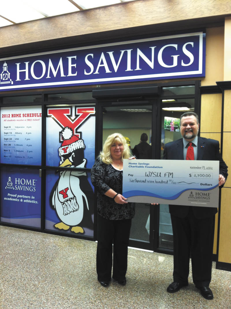 Home Savings Charitable Foundation recently donated $2,700 to WYSU-FM for annual program support. Shown holding the oversized check are Jeanne Watson-Antol, left, retail manager II of Home Savings YSU office, and Edward M. Goist, development office of WYSU 88.5 FM. Goist said WYSU-FM is committed to being the Mahoning Valley's leading source for in-depth news, engaging conversation and music that stimulates the mind and spirit. For more information on  WYSU-FM, call 330-941-3364 or visit wysu.org.