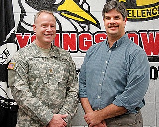 Army Reserve Maj. Rick Williams, left, officer in charge at Youngstown State University's ROTC, and retired Navy Petty Officer 1st Class Jim Szabo, human-resources assistant for the YSU ROTC, both work to keep the memory of Pearl Harbor Day alive.