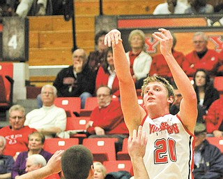 Youngstown State's Bobby Hain (20) hits a jump shot over Geneva's Matt Noyler (50) during the second half of Thursday's game at the Beeghly Center. The Penguins silenced the Tornados, 93-50, with Hain posting 16 points and 11 rebounds.