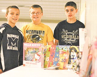 Jack Bucan, Ian Socha and Adam Price, all of McDonald, display toys they received for their birthday that they are donating to Akron Children's Hospital Mahoning Valley. They turn 12 Wednesday (12-12-12) and will celebrate with a party at Towjo's Bar and Grill in McDonald.