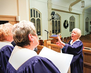 Margie Burnett, music director at Pleasant Grove Presbyterian Church in Youngstown, directs the adult choir in a rehearsal for Christmas vesper service planned at 4:30 p.m. Sunday. The service, in its 65th year at the church, is a Mahoning Valley tradition and signals the start of Christmas for many.