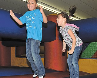 Isaac and Izabella Melendez, of Austintown, have a good time and are all smiles at Austintown Bounce. Austintown Bounce Indoor Play Center had an event Tuesday to teach bounce-house safety.