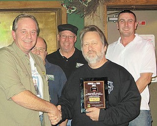 JT presents Lake Tavern owner John Palasics with the Burger Guys' 2012 Burger of the Year Award as Johnny, Scott and Eric look on.