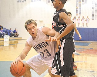 Poland's Alex Hubbell tries to get to the hoop as Campbell Memorial's Daron Clinkscale defends Tuesday night.