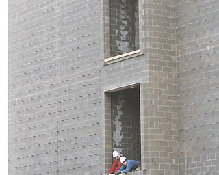 Work continues at the Austintown schools complex as windows and roofing are put into place. Construction for the new buildings, which will house kindergarten through fifth-grade classes, is right on schedule.