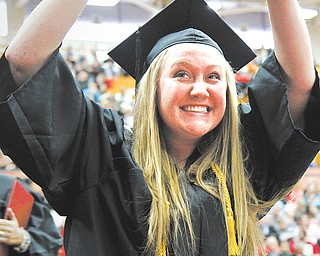 Samantha Rohrman reacts after receiving her degree in the college of liberal arts and sciences.