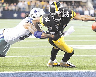 Pittsburgh Steelers wide receiver Antonio Brown (84) scores a touchdown as Dallas Cowboys cornerback Mike Jenkins (21) defends during the second half of an NFL football game on Sunday. The Cowboys outlasted the Steelers, 27-24, in overtime.