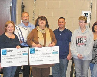 Hubbard Schools Band Sponsors won an aluminum can fund drive sponsored by the Ball Corp. for the third year in a row. Representatives from the local Ball Corp. plant in Hubbard were on hand at a recent boosters meeting to present the members with a check for $2,500 along with a check for an additional $2,500 of matching funds from the local plant. The Hubbard Band Sponsors have received over $10,000 in the last three years from the Ball Corp. All money goes into a fund for new uniforms. Pictured are, from left,  Ball personnel Amy Braden, Gary Flamino and Bob Truckiss; Andrea Lewis, assistant band director; Bernie Grilli, Ball Corp.; Cathy Cummings, boosters president; Dan Nestich, school band director; Pam Reiter, boosters vice president; Sandy Kerr, boosters treasurer; Ron Emch, boosters secretary; Chet Julian, Ball Corp.; and Sal Halicki and Maria Castner, boosters trustees.