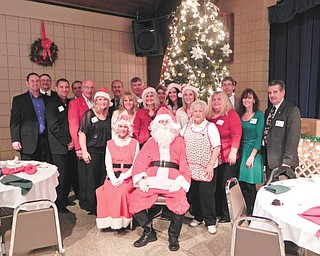 Youngstown Lions Club's 92nd Annual Christmas party for students of Youngstown City Schools had the Saxon Club filled to capacity. The children enjoyed singing and dancing to Christmas carols, eating a turkey dinner and opening their gifts from Santa, Mrs. Claus and the Lions Elves. Shown are members of the Lions Club, who had as much fun as the children.